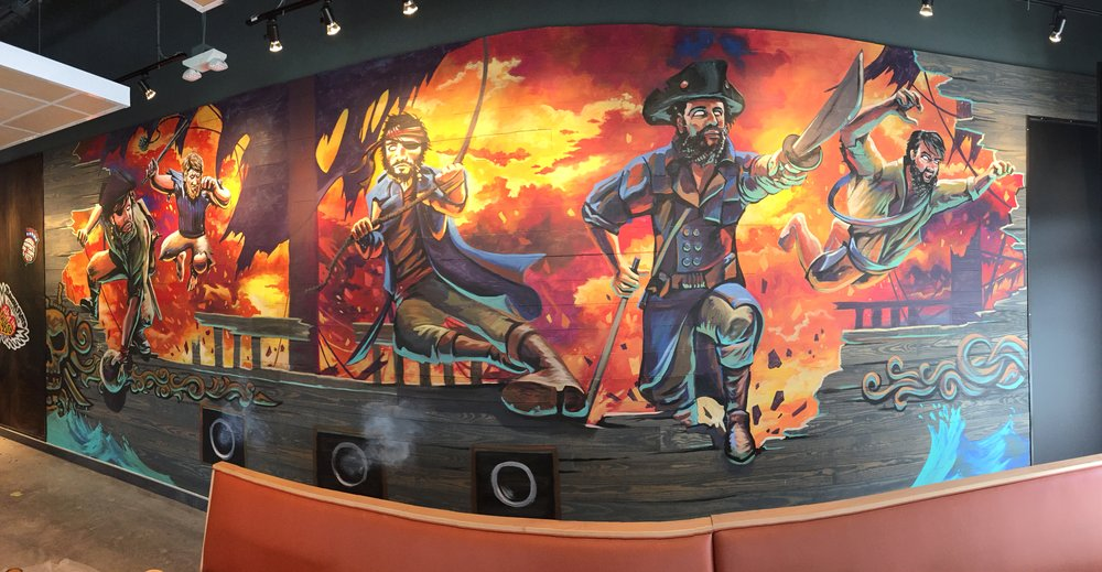 Pirates leaping off a ship to attack.  The mural is 10' x 25'
