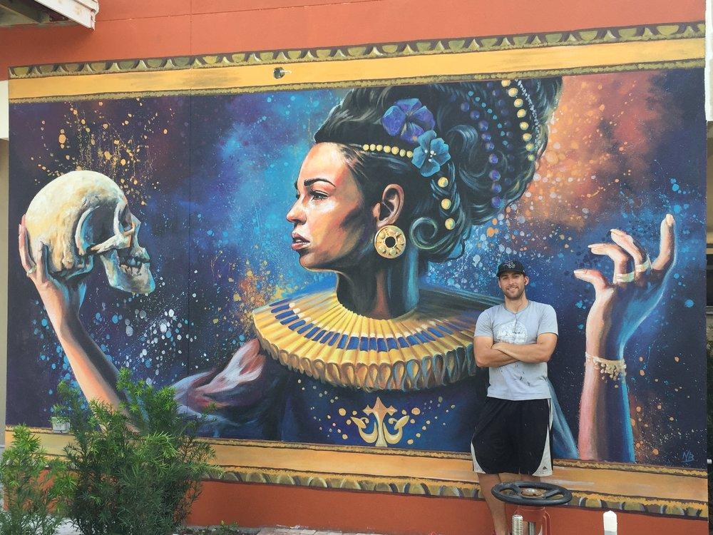 Finished mural of Lady Hamlet on the side of the Kretzmer Building in Sarasota, FL for Florida Studio Theatre