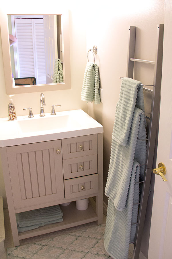 Martha Stewart vanity and Mirror.  Magazine rack serves as towel rack.