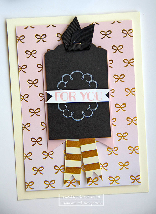 Create ribbon tails from the gold and cream card base.