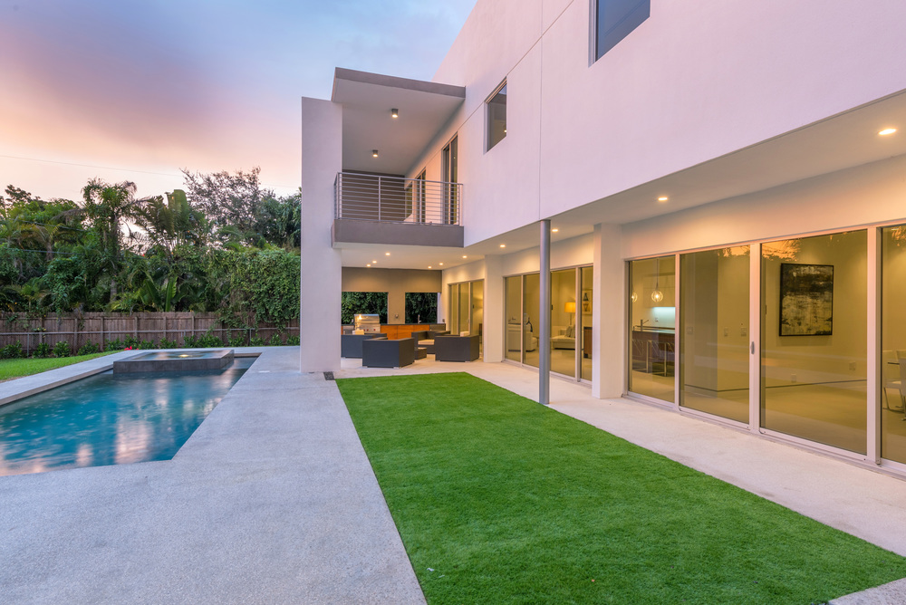 The Setting Homes Plum House Miami Florida Exterior Rear Dusk TARIS Real Estate