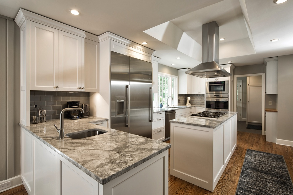 After: A kitchen designed for the future - unified aesthetic, flush-mount appliances, multiple work stations, plentiful counter and storage space, ample walkways and sight lines.