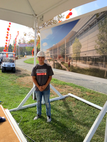 TIm G., a rising junior, looks like he just stepped out of the artist's rendition of the new campus on display at Oracle Parkway.