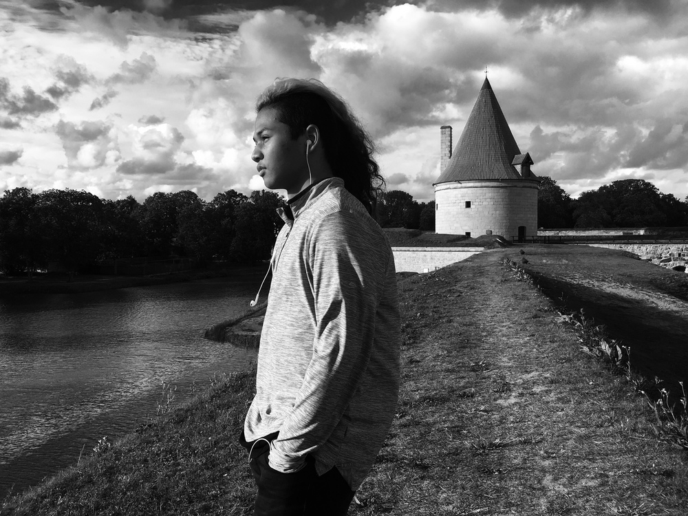 Bodhi, '18 Traveled through Europe this summer with my dad's band--Berlin, Germany and Riga, Latvia. I'm pictured outside the Kuressaare Castle in Estonia.