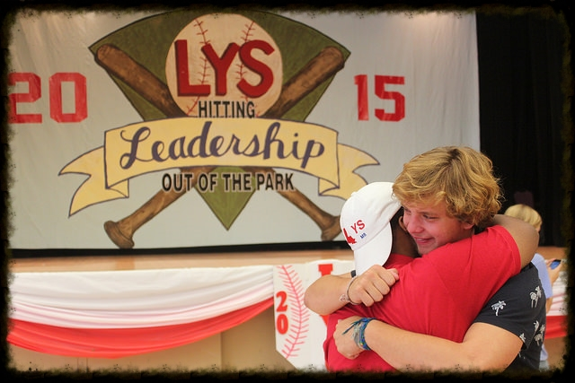 LYS staffer embraces a delegate at LYS 2015