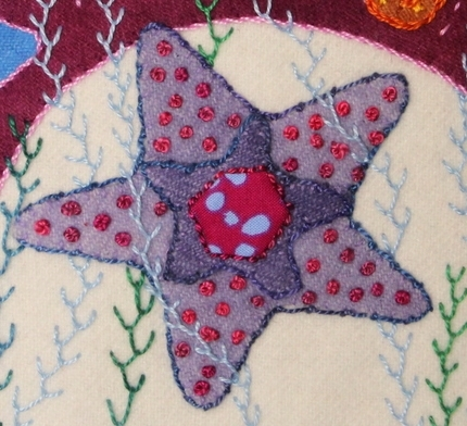 The Coral Stitch is done around the edge of the Starfish in a blue Valdani© size 8 cotton.