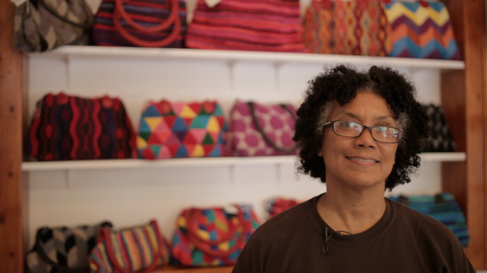 Yvette Jenkins began in  Love Travels Imports , a shop that connects Fair Trade, handcrafted work of artisans with people around the world.