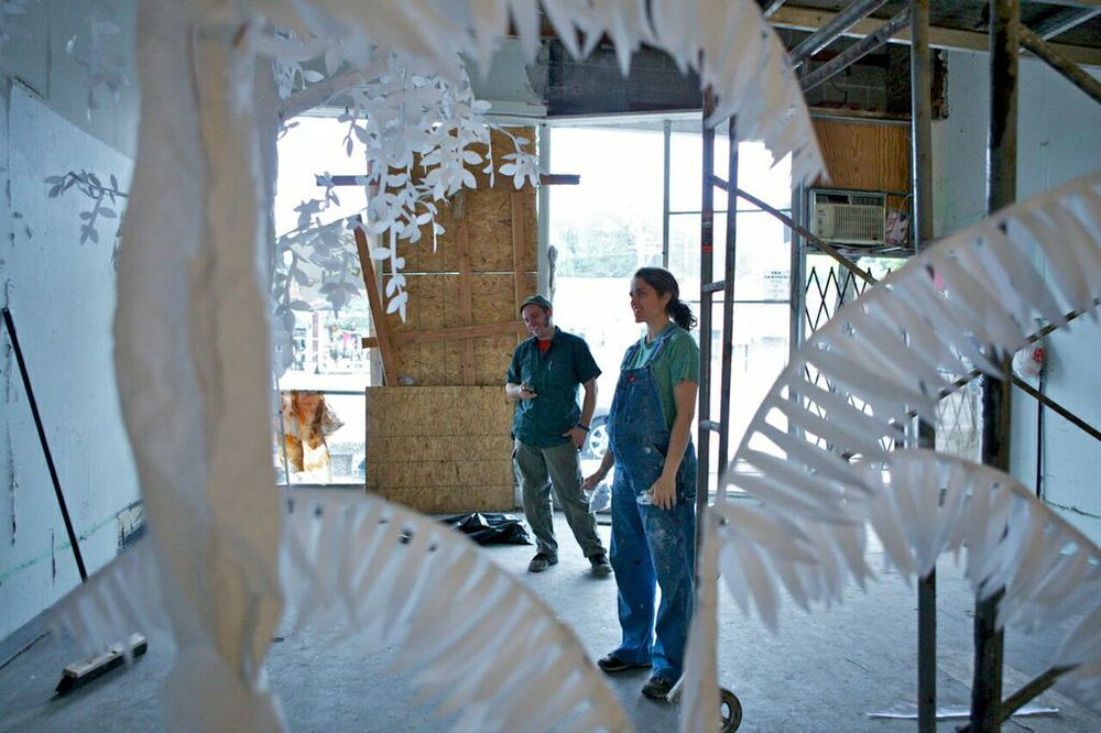 Artist Carrie Walker created  Ghost Jungle , a dream-like paper installation addressing the way nature will reclaim a building when given enough time, water, and light - by beginning with merely a seed.
