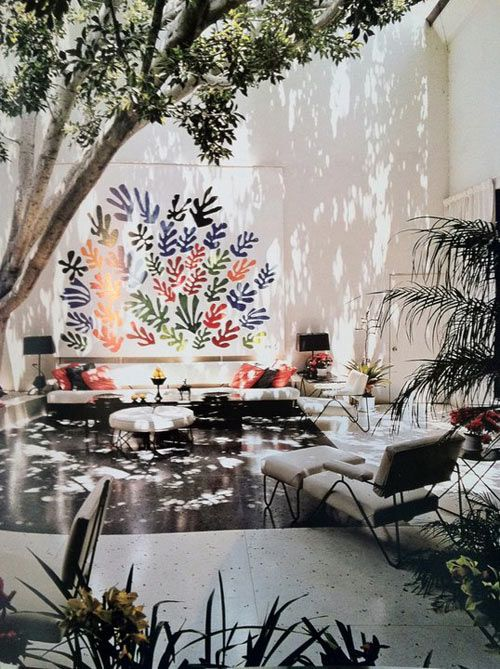 Large scale outdoor art grounded by living room clusters