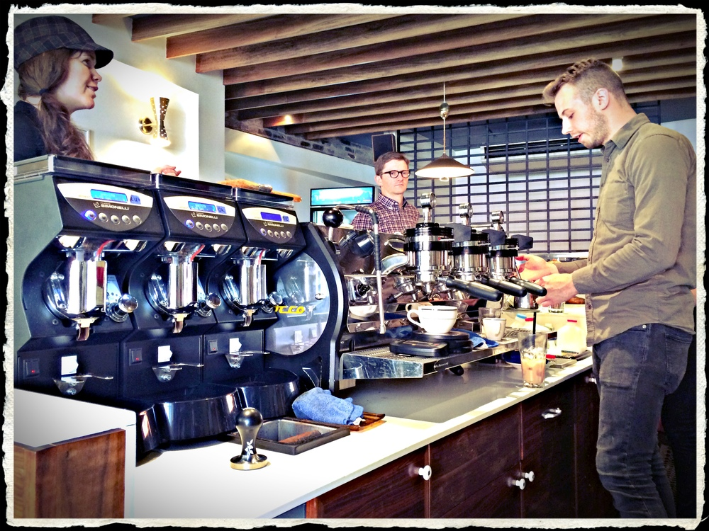 1.  With a bay of the new Mythos One grinders (custom painted, no less!  see below...) these cats are ready to make your espresso dreams come true.  That's Carissa there on the left doing some dreaming herself.