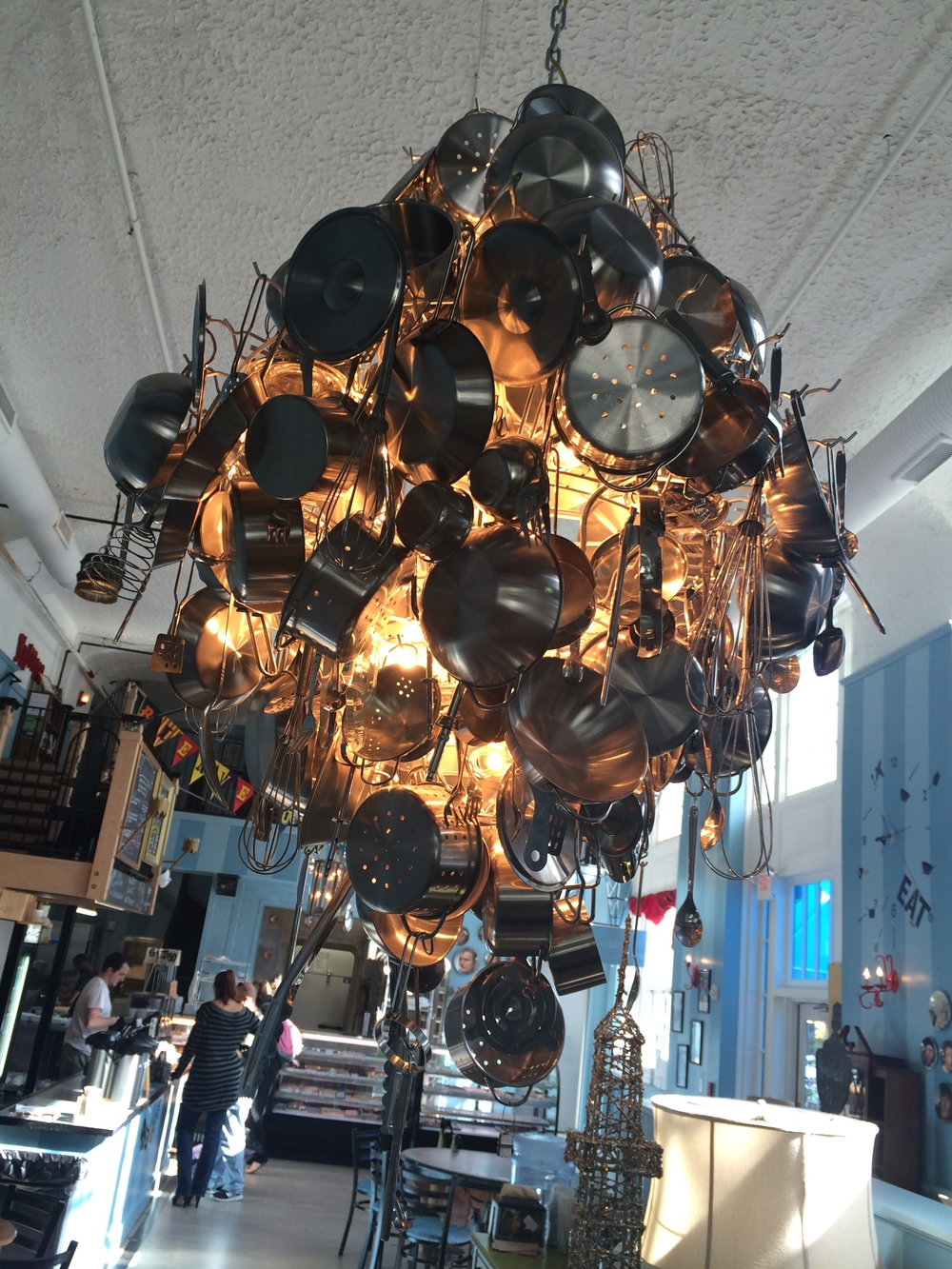 "2. Amelie's has a strong eclectic streak, with little fun touches like a map of France that says ""You are here....sorta"" and weird lighting pieces such as this chandelier made from cookware and another made from 3 foot long silverware."