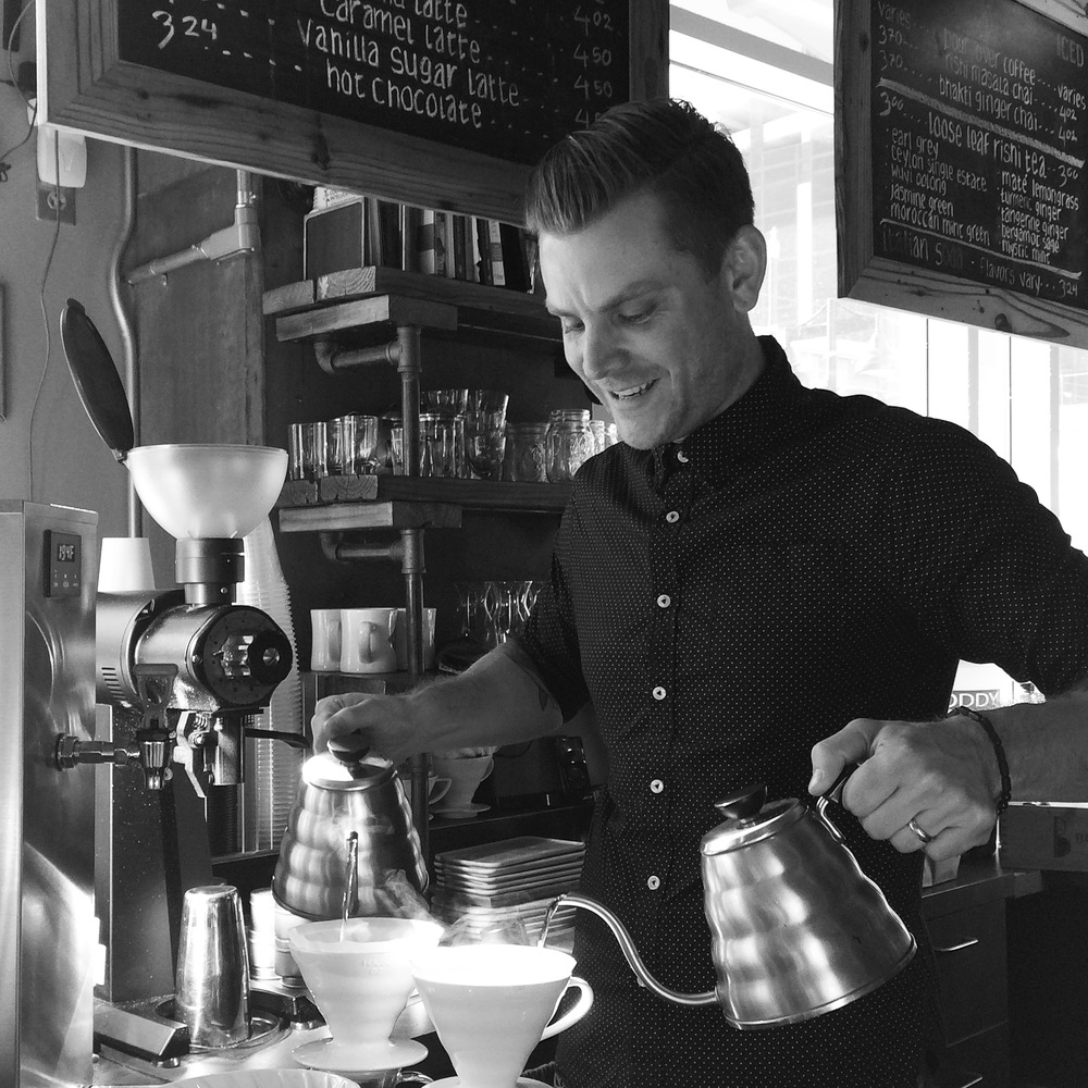 2.  This is owner James Yoder.  He really, really loves making pour overs.  I know this because I watched him make about a zillion of them and he was still smiling like this the whole time.  And he does it ambidextrously!  What talent!