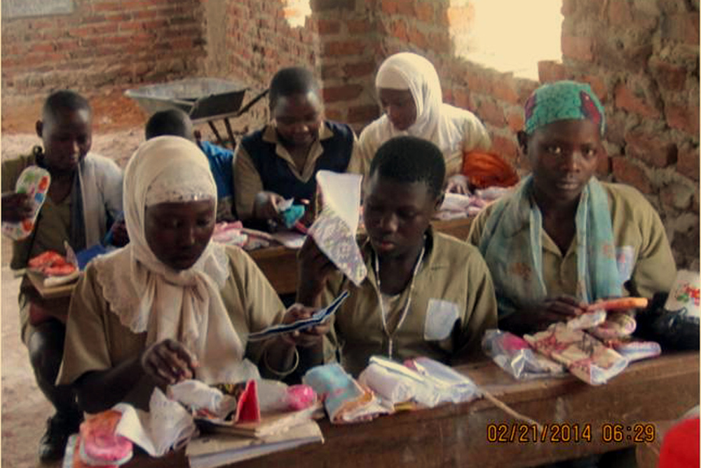Girls examining Sylvia's Sisters kits, February 2014 at Alliance High School in Uganda.