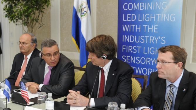 IMAGE DISTRIBUTED FOR SENSITY SYSTEMS INC. - El Salvador President Mauricio Funes, center left, and Sensity Systems Chairman and CEO Hugh Martin, center right, commemorate their agreement and partnership, with Franzi Hato Hasbun, El Salvador Secretary of Strategic Affairs and Minister of Education, left, and Rusty Cumpston, COO of Sensity Systems, during a ceremony on Thursday, April 18, 2013 in Washington. As a pioneer in Light Sensory Network technology, Sensity Systems is in advanced talks with the government of El Salvador regarding the best use and deployment of a LSN in the country's strategic infrastructure such as highways, public schools and El Salvador International Airport, among others. (Kevin Wolf /AP Images for Sensity Systems Inc.)