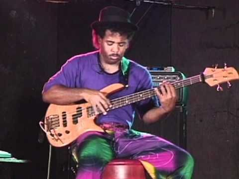Victor Wooten back in the day with hair tie on neck.