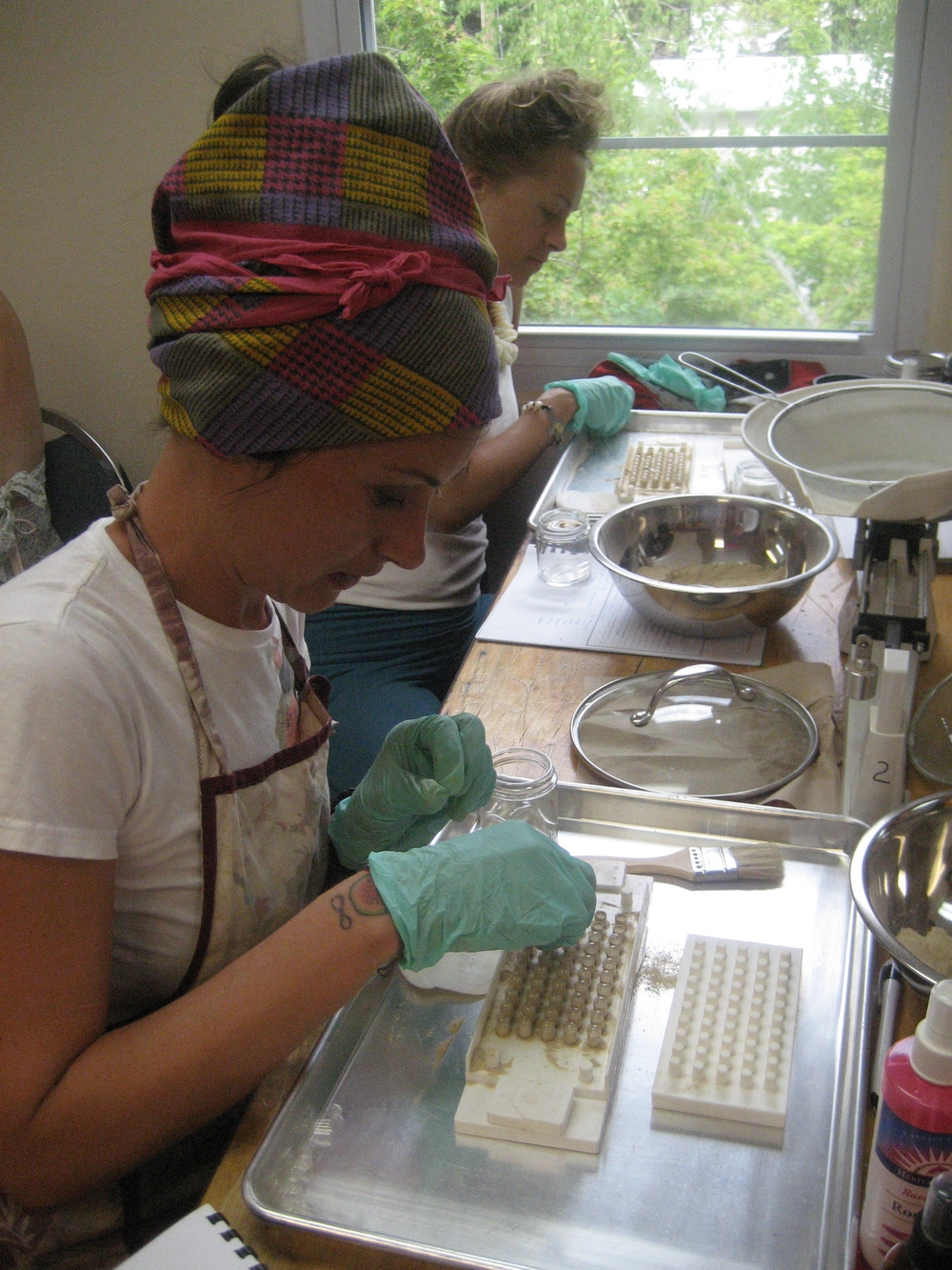Eva makes herbal medicine during a California College of Ayurveda course.