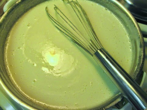 {Add the cheeses in batches, making sure to whisk constantly so it doesn't burn!}