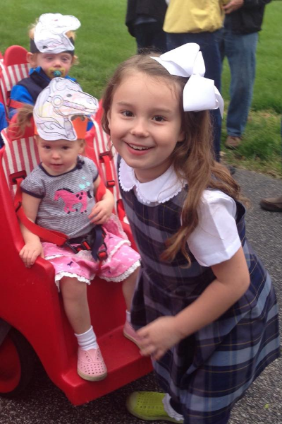 Eloise's sisters Anne-Miriam and Bea take in the parade