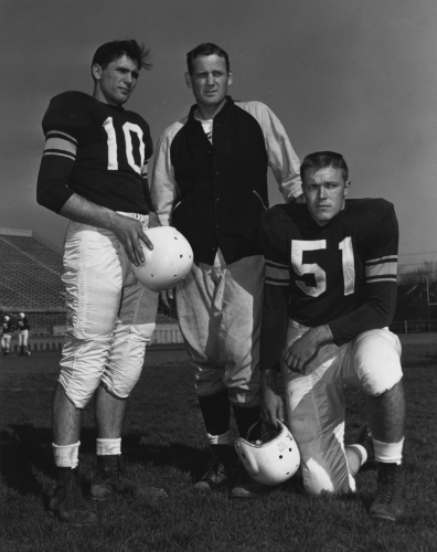 Kentucky Coach Bear Bryant with Team Captains Vito Parilli and Doug Mosely, 1953.  Image via KDL