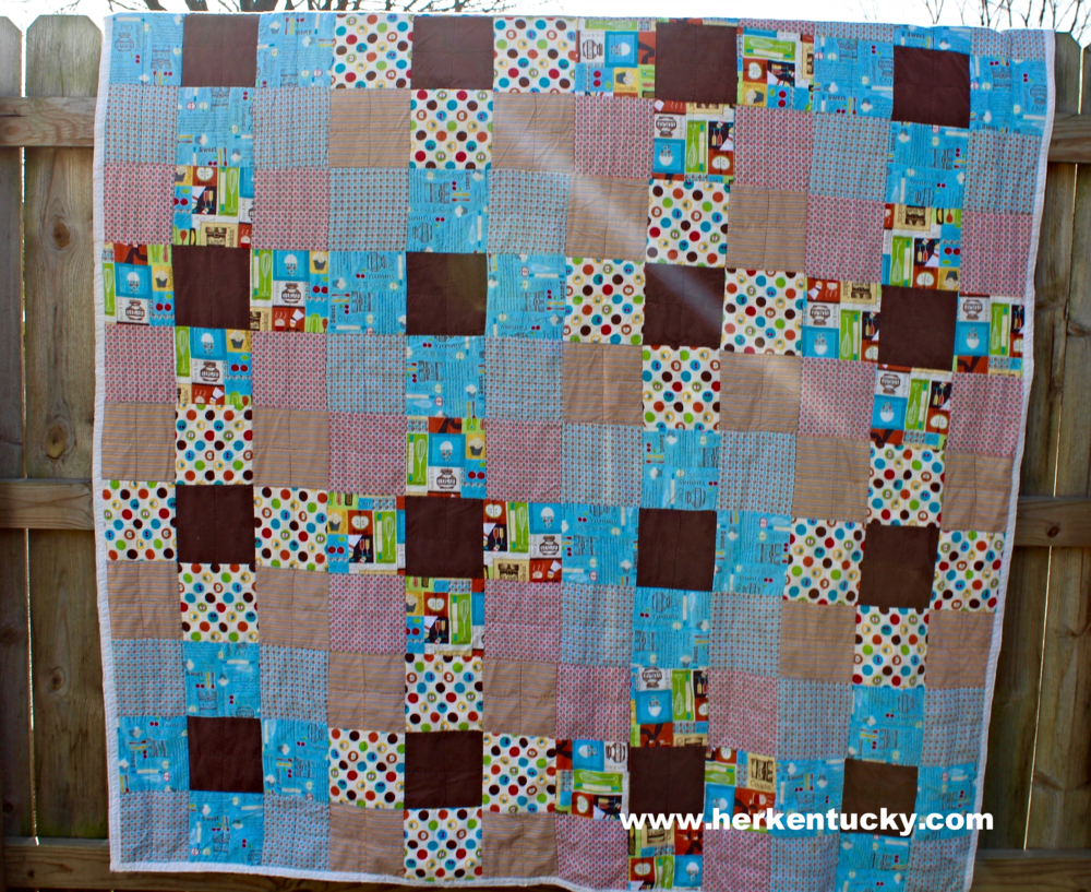 blue and brown patchwork quilt