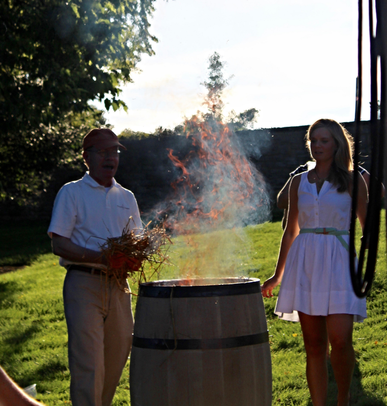 Woodford Reserve Master Distiller Chris Morris and Master Taster Elizabeth O'Neill char a barrel.