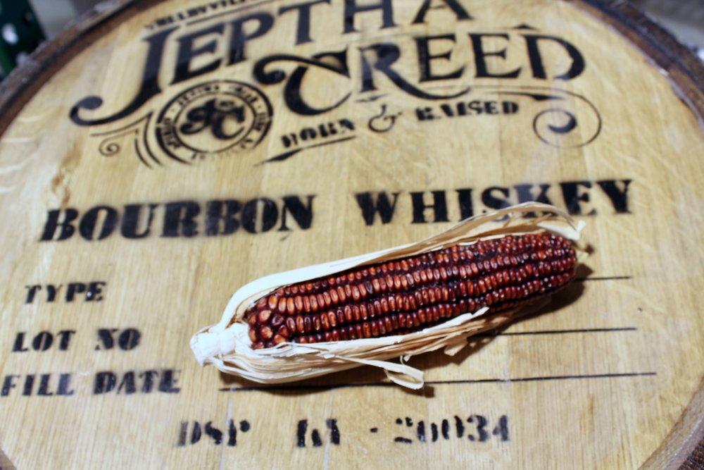 Bourbon's mash bill is 51% corn. Jeptha Creed uses an heirloom varietal, Bloody Butcher Corn.