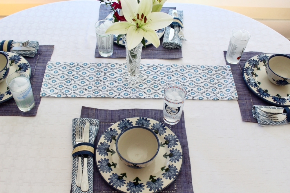 Raffia Indigo Napkin Rings, Provence Blue Tea Towel, Indigo Napkins, and Blue Raffia Hemstitch Placemats c/o Pomegranate Inc