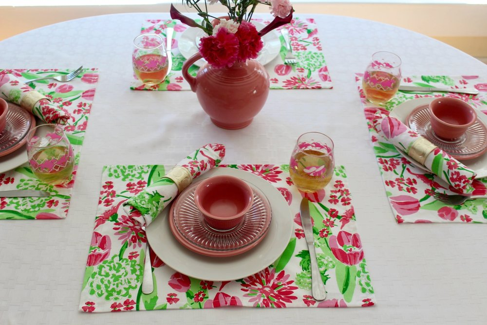 Tulip Trot napkins and placemats and Baldwin Gold Napkin Rings c/o Pomegranate Inc.