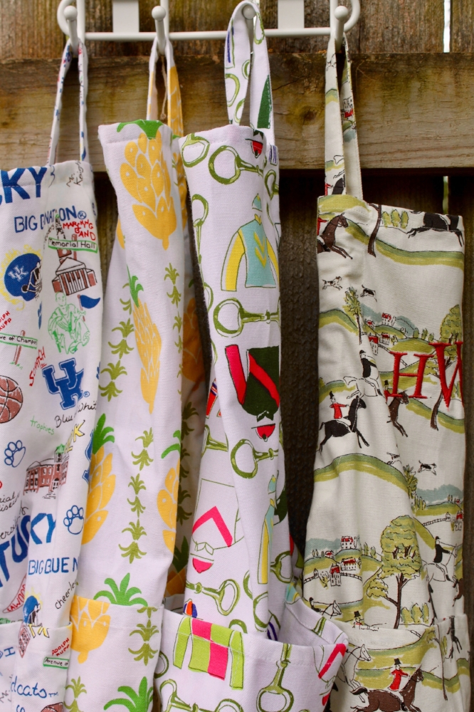 UK Collage, Pineapple Citrus, Pick Six, and Hunt aprons c/o Pomegranate.