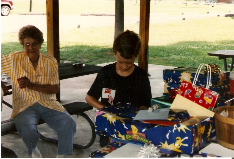 My brother opens some sweet Power Rangers gear at his birthday party, as my grandmother looks on. Jenny Wiley State Park.