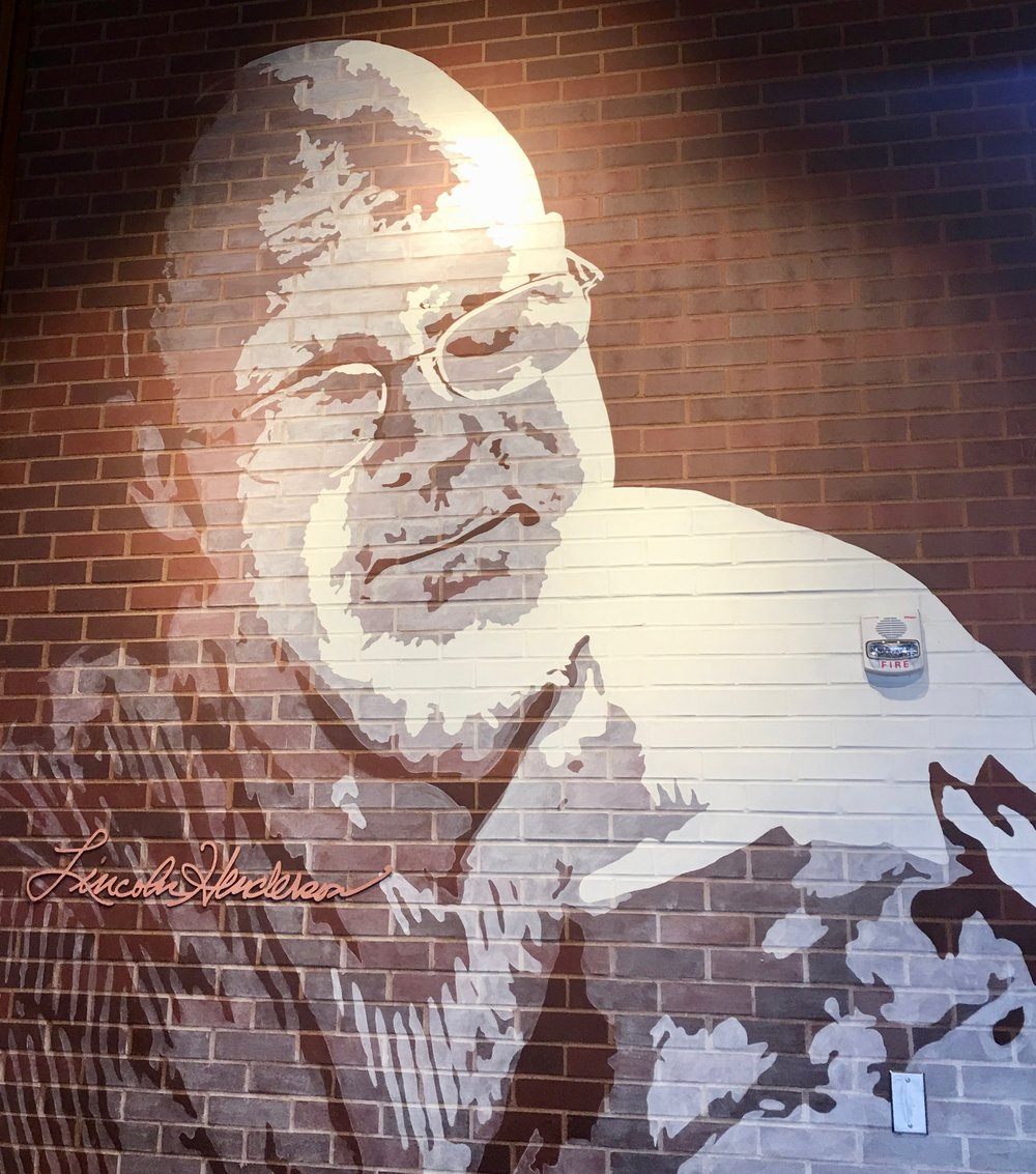 A mural at the entry of Angel's Envy pays tribute to legendary distiller Lincoln Henderson