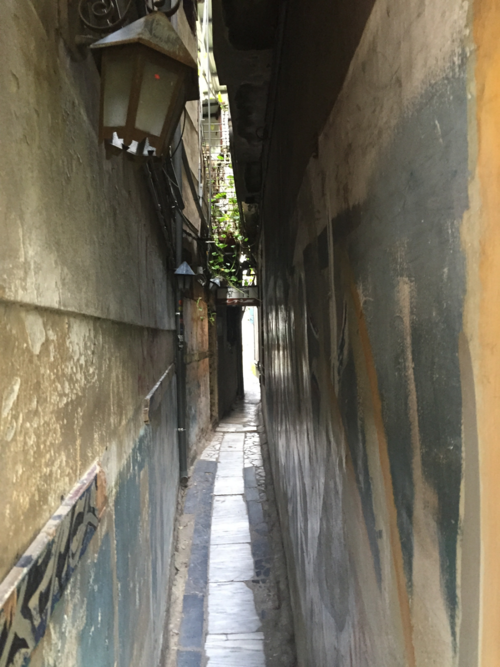 An extremely narrow alley with a cafe hidden within.