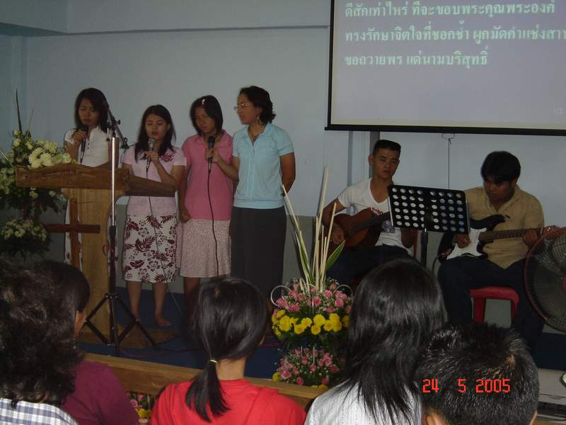 That's me in blue singing worship songs with my friends, praising the Lord for His blessings.