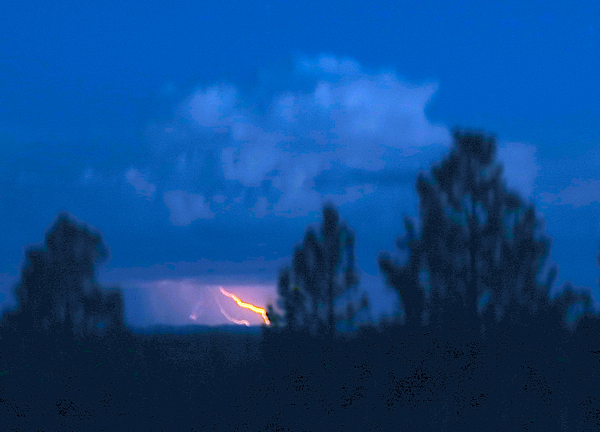 Huge storms to the east gave us a light show both nights.  I got this very blurry shot of lightning over Mesa Verde.  Yes, it sucks.  It's just for illustrative purposes.