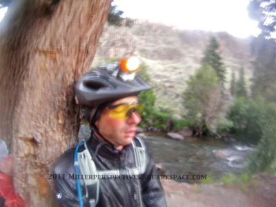 Aaron Weinsheimer, asleep ten seconds after sitting down on the side of the CTR route.  We'd ridden from 4:00am to midnight the day before, then awoken at about 2:00am to tackle Los Pinos, Slumgullion, and Spring Creek Passes, then CT Segments 22/23 to Silverton.  We made it to Silverton around 9:00pm and back to Durango the following day.  (Chris Miller photo)