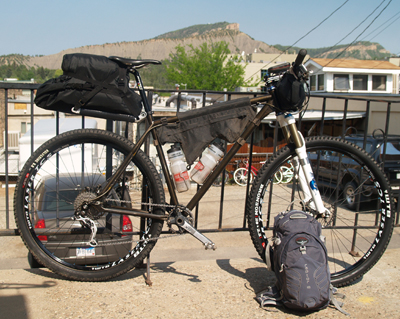 Joey's Redline Monocog Flight, set up as a 1x9 for the 2011 CTR, with homemade bags and an Osprey Raptor 18.  The homemade seat bag was later changed to a much smaller, more stable design.