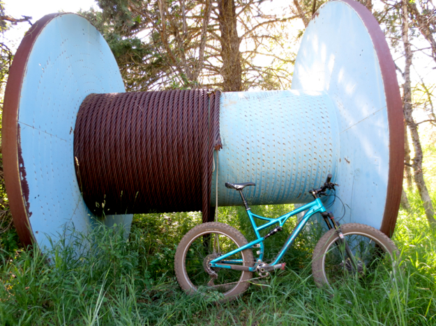 Yep, you can ride one of these.  Sorry, giant cable spool not included...