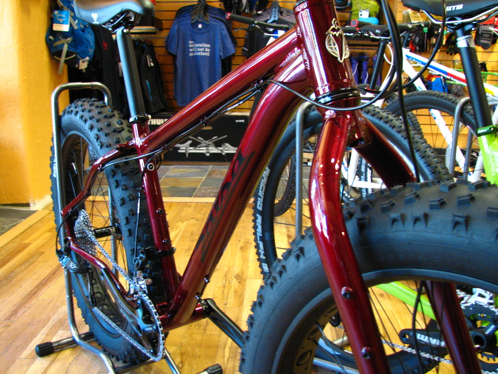 Mukluk 3 in Ruby Red.  For 1900 bucks, this thing is a pretty screamin' deal - 82mm rims, Nate tires, tapered fork, nice drivetrain, and hydraulic brakes.