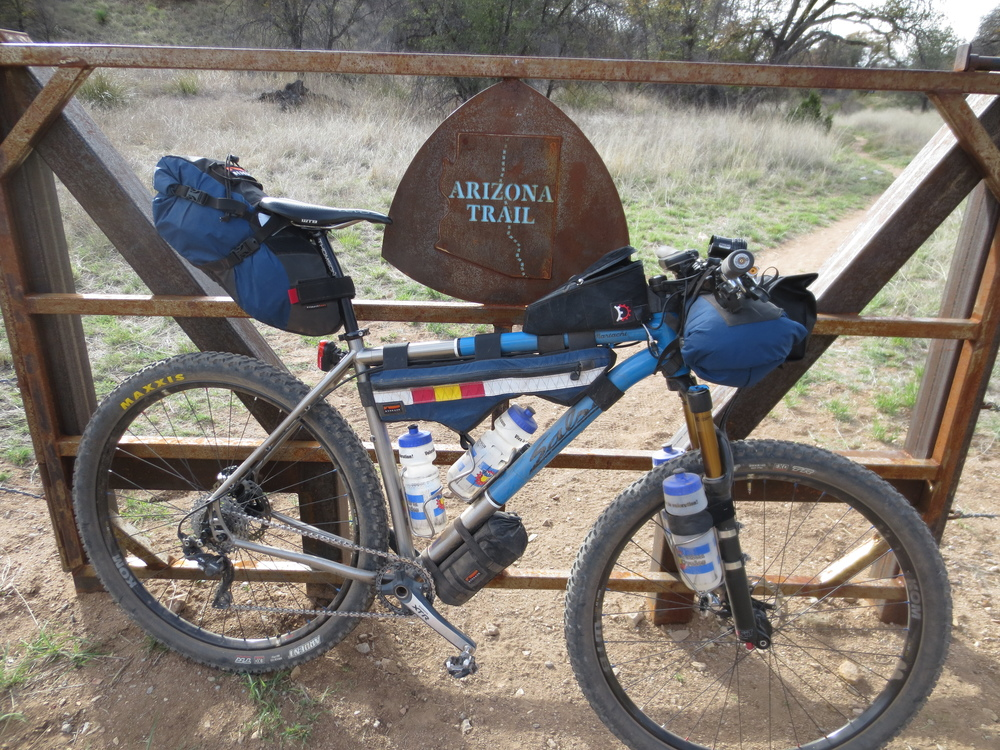Joey's current rig, a Salsa El Mariachi Ti, on the Arizona Trail.  This full-Bedrock setup places all the gear, food, and water on the bike - no backpack!  There are three full days of food and 4.5 liters of water in the setup pictured, along with lights for night riding, navigation, and a full sleep system.