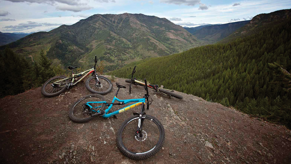 Three bikes hangin' out on a mountaintop.