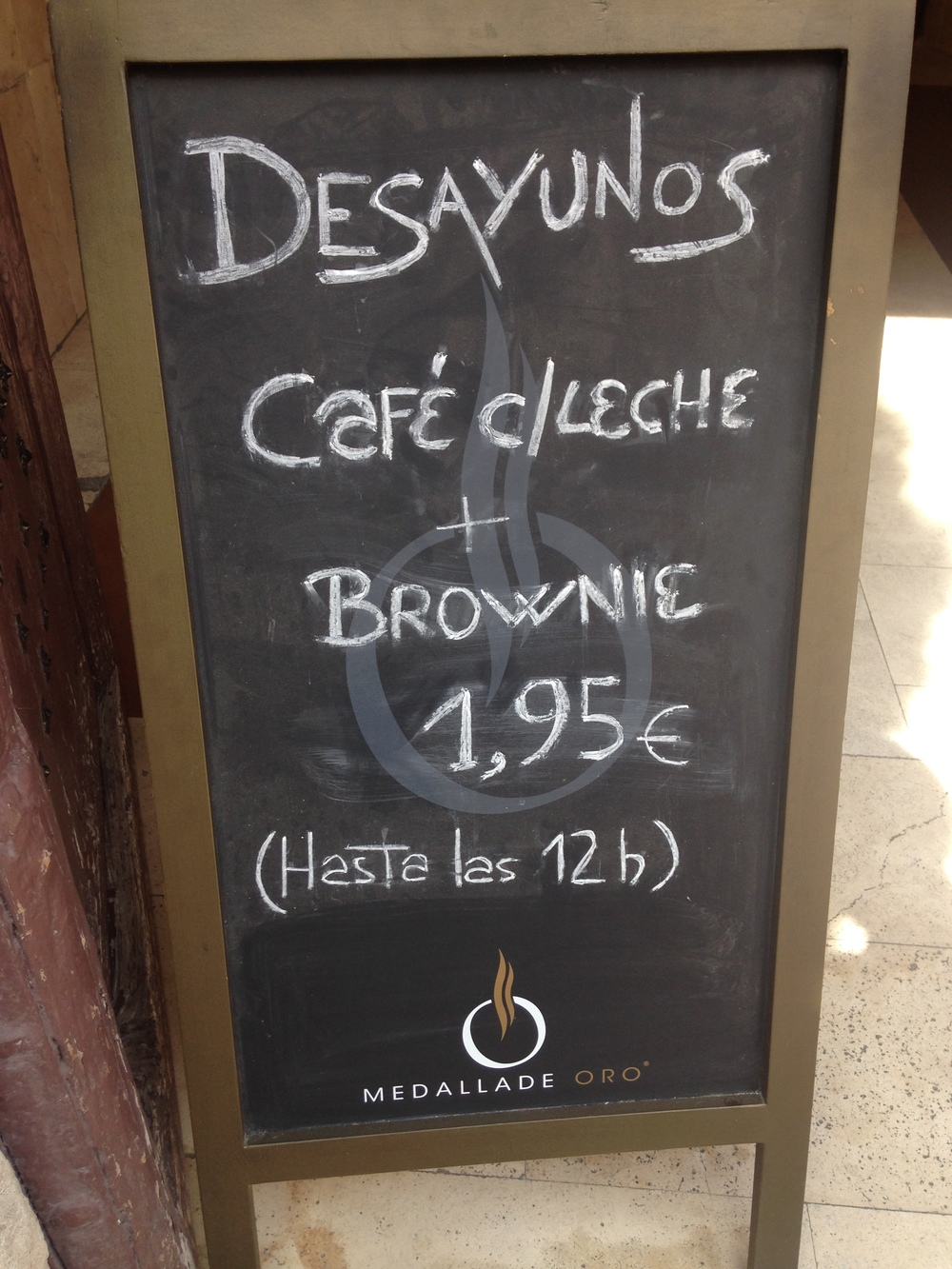 "I saw this sign walking home today. It reads, ""Breakfast: Café con Leche and Brownie, 1.95 (Until 12).¨ Brownies are one of my favorite food groups! I have to go to there."