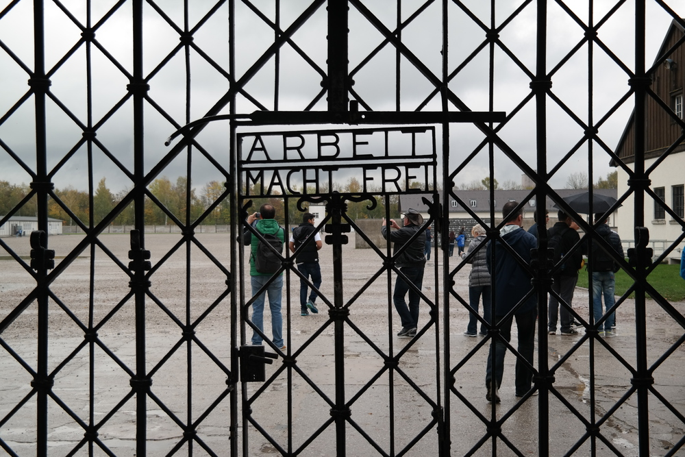 """""""Work Makes You Free:"""" text on the gate entering into the Dachau concentration camp."""