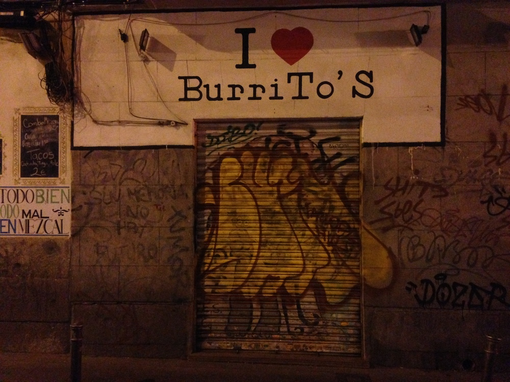 Oh, the horror of the misplaced possessive apostrophe. You love [the] burrito's...taste? flavor? presence in Madrid? I love burritos, too, just not  burrito's.