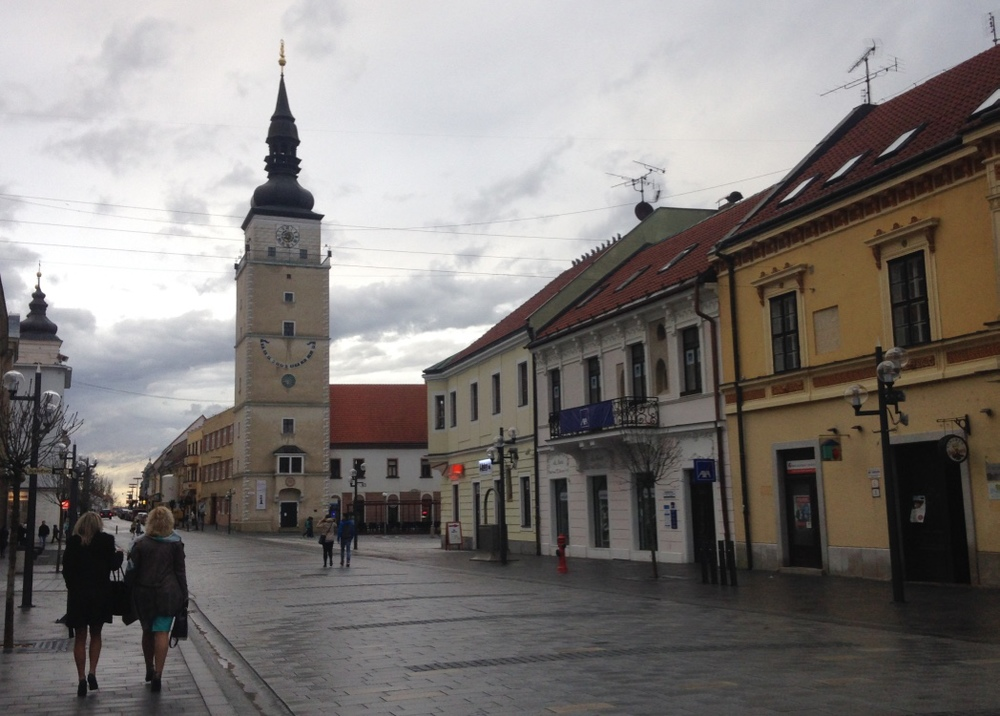 "The main street in ""downtown"" Trnava, leading to the main square."