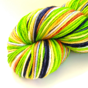 Popsicle! (in Worsted Superwash)- bright green with navy blue, light gray, and pale yellow with a hint of peach