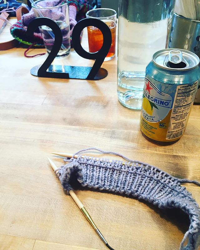 The only photo I got of @bohoknitterchic and I yarn crawling this year. Taking a much-needed lunch/drink break at what is apparently the place we like to eat lunch every year when yarn crawling downtown. . #rcyc #lunchknitting #yarncrawling #downtownportland #wip #tinyvest #handdyedyarn #sunrisefiberco