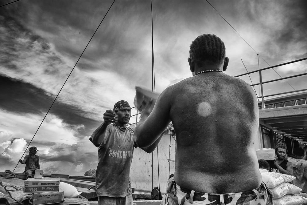 """Workers"" Munda, Solomon Islands. photograph : Russell Shakespeare"