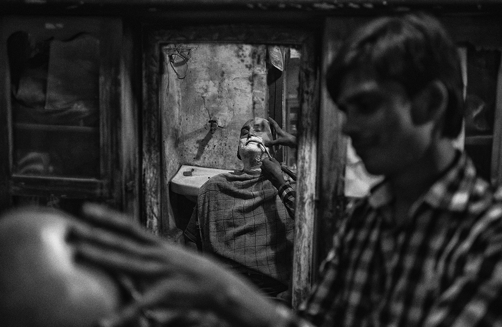 """Barber Shop, Varanasi""   photo copyright : Russell Shakespeare 2015"