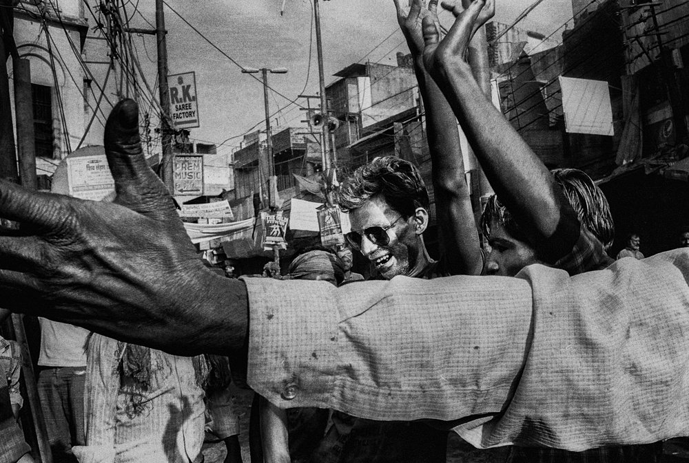 """Holi Festival"" Varanasi, India. photographed with a Nikonos-V film camera using Tri-X 400 . ©Russell Shakespeare"