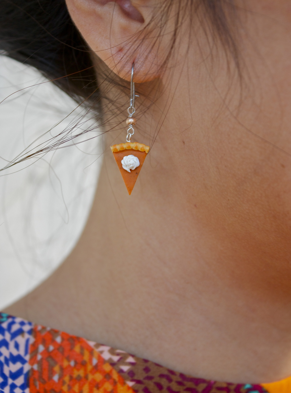 close up of pumpkin earring
